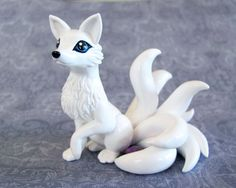 White 8 Tailed Kitsune by DragonsAndBeasties.deviantart.com on @deviantART