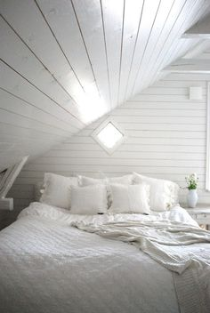 diamond window + white paneling + attic rooms