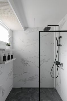 """Luxurious marble accents, a feature wall and a """"Narnia"""" wardrobe, this Bukit Batok home's transformation is one for the big screen! Bathroom Design Small, Bathroom Interior Design, Modern Bathroom, Minimalist Bathroom Design, White Marble Bathrooms, Marble Showers, Downstairs Bathroom, Master Bathroom, Toilet Design"""