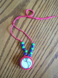 Earth Day Necklace from a Milk Jug Lid -  Pinned by @PediaStaff – Please Visit http://ht.ly/63sNt for all our pediatric therapy pins