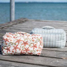 Cosmetic bag in quilted flower print or dusty blue stripes - with organic cotton filling. Perfect for travelling or in you bathroom. GOTS certified. Fair Trade Clothing, Knitted Throws, Dusty Blue, Kids Wear, Blue Stripes, Cosmetic Bag, Hoods, Travelling, Organic Cotton