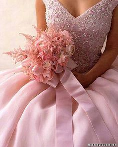 Pink wedding gowns with chiffon, lace, and pearls