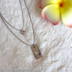 2-in-1 Necklace 2 necklaces that can be worn together or separate. Silver with pink stones. In good condition. Courreges Jewelry Necklaces