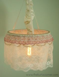 William and Sally decor tip: Love the special touch this could give to a nursery!   DIY Lace Chandelier with tutorial!