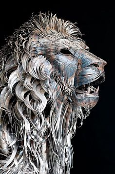 Lion Sculpture made of hammered scrap metal. This work by Turkish sculptor Selçuk Yılmaz titled Aslan (which means Lion in Turkish).  6 feet tall, and 10 feet long - 10 Creative & Famous Lion Sculptures Outdoor Art