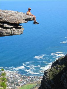 So, you like just hang out. This hiker really likes to hang out. After a hike, in South Africa, this hiker is taking a relaxing break on the edge of a cliff rock. The photo comes from our good friends at South African Airways, Table Mountain, Mountain Art, Mountain Homes, Cape Town Holidays, Me Time, Travel List, Natural Wonders, Hanging Out, South Africa