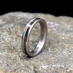 Koa Wood Sleeping Beauty Turquoise Inlay Titanium Wedding Band ,Available in carbon fiber, titanium, red or yellow bronze bands at the same price. Titanium Jewelry, Titanium Wedding Rings, Custom Wedding Rings, Unique Wedding Bands, Titanium Rings, Wedding Ideas, Wedding Stuff, Wedding Inspiration, Ring Pictures
