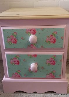 Very pretty bedside table in pink with decoupaged drawers.