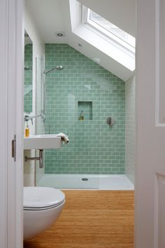 I love this green tiled shower and overall design of the room