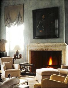 Axel Vervoordt.... moody. Love the fireplace and old world feel.