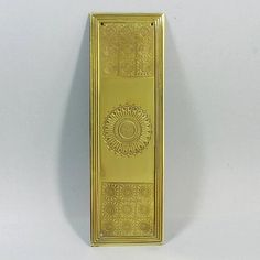 An unusual and decorative brass three quarter height fingerplate. Finely worked and in excellent overall condition. See images for details. We believe the engravings show stylised images of the sun, possibly Asian in origin.