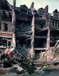 1940 London at War - London Bus 1940 - Wreckage of bus leaning into huge crater in front of bombed out buildings, a result of German aerial blitz attacks during the Battle of Britain. WWII (V) London History, British History, World History, World War Ii, London Bus, Old London, Blitz London, London Street, The Blitz