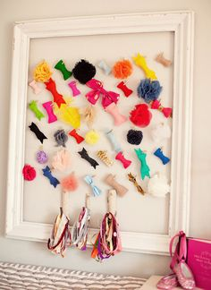 Organize your kids' hair bows by clipping them to a vintage picture frame.