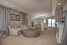 Unwind after a long day in this stylish bedroom seating area. North Redington Beach, FL. http://redingtongrand.com/