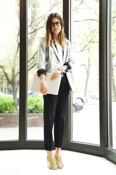 Leandra wearing a Rag and Bone blazer, Kain blouse, The Kooples trousers, Kimberly Baker necklace, Proenza Schouler shoes and Warby Parker frames.