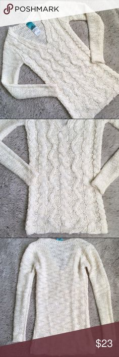 Ivory Knit Sweater-EUC Cream colored thick knit sweater with a deep v neck.  Cable knit front.  Larger weave so skin does show through a bit. In great condition! Very cute on hits below the hips. Sweaters V-Necks