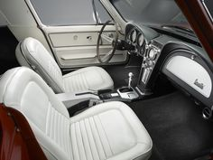 This is one gorgeous 1967 Stingray Corvette with a white interior. Don't you wish they'd make a different interior color than black these days? http://www.winthevettes.com