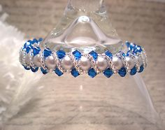 The Stella Swarovski Silver Pearl and Capri Blue Crystal Bracelet by NiteDreamerDesigns, 10% of sales goes to Shark Savers