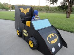 Batmobile for Birthday Party Use a motorized jeep, cardboard, hot glue and your imagination. Enjoy a functional batmobile.