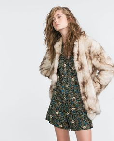 Pair a floral playsuit with a faux fur coat this Spring for a must-have look