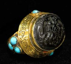 Ottoman Gold Ring Inlaid with Turquoise Featuring a Seal - OS.128 Origin: Turkey Circa: 16 th Century AD to 19 th Century AD