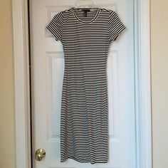 Black and white striped midi dress Very cute dress that can be dressed up or worn casually. It has a cute cut out in the lower back area. Dress only worn once. Forever 21 Dresses Midi