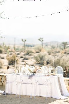We love this modern table setting with clear chairs, white linens and neutral toned florals captured by Meaghan Brianne Photo on Aisle Society! Wedding Desert Table, Summer Wedding Cakes, Wedding Locations California, California Wedding, Southern California, Ocean View Hotel, Ghost Chairs, Malibu Beaches, Minimal Wedding
