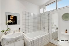 White bathroom in Clifton Hill.  Real estate photography by CT Creative.