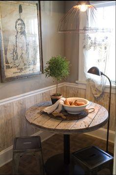 love the artwork..., sweet, little/bistro style kitchen nook...