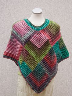 Love this knitted poncho in Noro.... Jan Eaton has a very similar crocheted square...... Hmmmmm.... Ideas!!!                                                                                                                                                                                 Mais