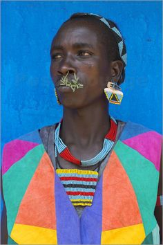 Tsemay man in colourful clothing at weekly market, Key Afir, Lower Omo valley.