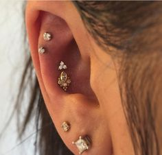 Double Conch piercing by Nate Janke of St. Sabrinas. Jewelry by BVLA.