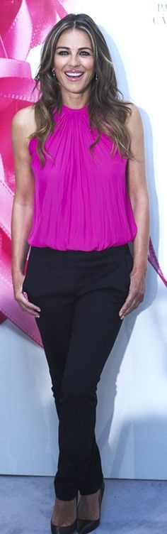 Who made  Elizabeth Hurley's pink pleated top, black pumps, and jewelry?