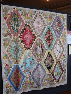 hexagon quilt by Bridgett Giblin From her book Feathering the Nest with Vintage Inspired Quilts.