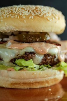 The ultimate beef burger recipe with bacon, cheese and pickles.