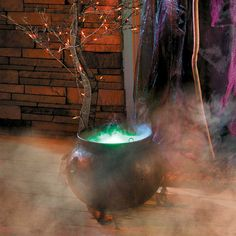 "Brew up a spooky Halloween with this misty witch's cauldron. Black, realistic-looking cauldron is draped in black gauze and uses water and light to create a misting, ""boiling"" look (water not included)."