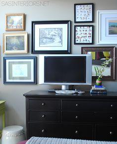 Creating a gallery wall behind a TV by @Jenna_Burger, www.sasinteriors.net