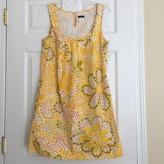 J.Crew yellow flower print cotton dress THE perfect dress for summer! Bright and cheery! Only worn once and in perfect condition! 100% cotton. Lined. 34 inches long. J. Crew Dresses