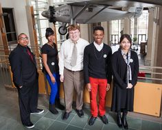 The Teens Make History Exhibitors pose during the opening night of the Between Two Worlds exhibit at MHM. Left to right: Tyshaun Randolph, Rachele Banks, Jacob Laseter, Vaughn Davis, and Devi Acharya. These young people, in partnership with Museum staff, have taken the exhibit from proposal to installation. Between Two Worlds examines the experience of veterans as they deal with separation from home, struggle to maintain communication with loved ones, and transition back into civilian life.