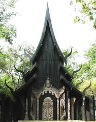 The work of Thai artist Thawan Duchanee. The grounds include nearly 40 small black houses made of wood, glass, concrete, bricks or terracotta in various unique styles and design. Inside them are his collections of paintings, sculptures, animal bones, skins, horns and silver and gold items from around the world.