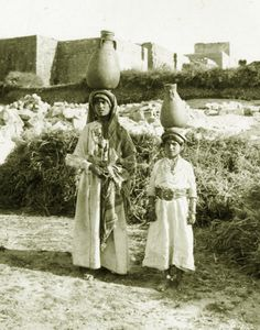 Ramallah-رام الله: Two Ramallah girls carrying water jars, ca. 1920 - (Photo by Chalil Raad, Palestine's first Arab photographer, 1854-19...