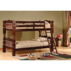 @Overstock - Carved Spindle Esprit Cherry Finish Bunk Bed - Constructed of solid pine wood, this bunk bed includes 14 wood slats. This bunk bed easily separates into two beds and includes a ladder and safety rail for the top bunk.  http://www.overstock.com/Home-Garden/Carved-Spindle-Esprit-Cherry-Finish-Bunk-Bed/7600047/product.html?CID=214117 $391.98