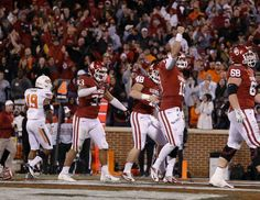 Oklahoma's Blake Bell (10) celebrates after scoring a touchdown at the end of regulation during the Bedlam college football game between the University of Oklahoma Sooners (OU) and the Oklahoma State University Cowboys (OSU) at Gaylord Family-Oklahoma Memorial Stadium in Norman, Okla., Saturday, Nov. 24, 2012. Oklahoma won 51-48. Photo by Bryan Terry, The Oklahoman