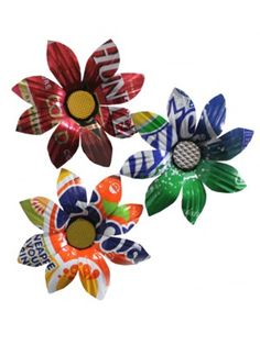 Brightly coloured magnets made from recycled drink cans. Each flower is a different combination of colours and patterns depending on the can that has been used. They are not only gorgeous  they display an impressive ability to find value in something we assume is valueless.