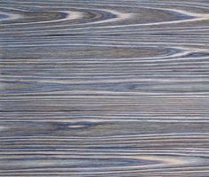 Delta Millworks'  Tiger Blue Granite cypress. Burnt or Charred then wire brushed in the traditional delta millworks method.