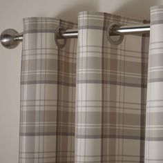 Finished in warm ochre with a traditional chequered design, this pair of fully lined curtains are complete with a modern eyelet header, available in a selection of widths and drops.