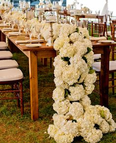 White Hydrangea Table Runner | 9 Flower Table Runners You'll Love! | https://www.theknot.com/content/9-flower-table-runners-youll-want-on-your-reception-tables
