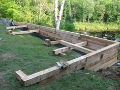 Some types of Wood Retaining Wall: Wood Retaining Wall With Weeds ...