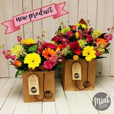 This bouquet is beautifully crafted of brightly coloured local in season flowers…