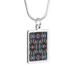 Colorful blue pink pattern on black Silver Portrait Necklace on CafePress.com
